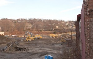 Construction equipment sits on Parcel C at the corner of Maple and Water streets in Naugatuck in 2010. The Regional Brownfields Partnership of West Central Connecticut worked with Naugatuck on the remediation of the site. The organization has started a new Land Bank program with the goal of turning brownfield sites into productive parcels again. –FILE PHOTO