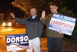 Mayoral candidate Anthony Dorso, left and Board of Education candidate Jeffrey LaMontagne campaign outside the Fire House in Prospect Tuesday evening. Both lost their races to Republican incumbents.