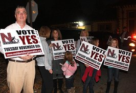 Jim Goggin, supports a 'yes' vote on the Naugatuck High School renovation referendum outside the Naugatuck Train Station Tuesday evening. The referendum passed 1,756 to 944.