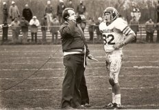 Former Naugatuck head football coach Craig Peters led the Greyhounds to their first state title in 1981 with a 28-6 win over Xavier. In that game, he confers with John Lynn (82).