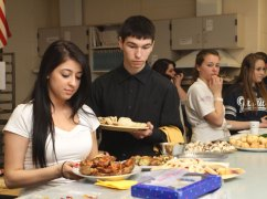 Students prepared hors d'oeuvres for parents and teachers for an event Monday morning. - LARAINE WESCHLER