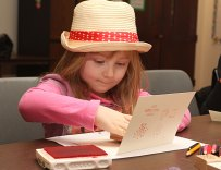 Kendra Light, 4, stamps out a Valentine's Day card at the Prospect Public Library Feb. 10.