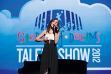 Prospect teenager Alyssa Casson, 13, sings Christina Aguilera's 'Beautiful' during the Garden of Dreams Spring Talent Show at Radio City Music Hall April 5. Casson beat rhabdomyosarcoma, a rare soft muscle tissue cancer. -AVI GERVER/MSG PHOTOS