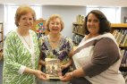 Beacon Falls Historical Society President Beverly Krenesky presents a copy of the new book 'Images of America: Beacon Falls' to Laurel Ledge Elementary School Librarian Bea Ellingson and Principal Regina Murzak.
