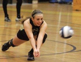 Woodland's Rachel Starkey dives for the ball Oct. 18 versus Seymour. The Hawks won the wild match 3-2.