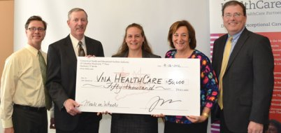 """VNA HealthCare recently received a $50,000 grant from the Connecticut Health and Educational Facilities Authority to support its Meals on Wheels program. The grant will allow the agency to deliver approximately 5,000 additional meals to those who need assistance with paying for meals. """"This grant will provide about 5,000 home delivered, nutritious meals to over 200 individuals in need. Such a partnership of public and private dollars will help ease Connecticut's pangs of hunger and give our neighbors a better chance of healthy, productive lives,"""" President and CEO of VNA HealthCare Ellen Rothberg said in a news release. VNA HealthCare provides home health care, hospice care and private duty independent living services to more than 60 towns in central Connecticut and greater Waterbury. Pictured: Connecticut Health and Educational Facilities Authority officials present a $50,000 check to VNA HealthCare staff."""