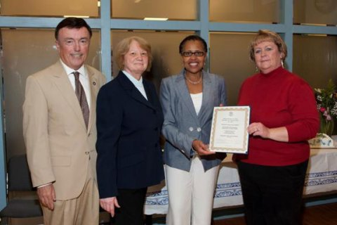 Connecticut Commissioner of Public Health Jewel Mullen, third from left, presents Chairman of the Naugatuck Valley Health District Board Susan Carter of Derby with the commissioner's citation commending the health district for 40 years of service during an open house and ceremony June 12 at the health district's office in Seymour. The ceremony featured along with the commissioner's citation, a citation from the state legislature, and a letter of commendation from U.S. Congressional Representatives Rosa DeLauro. The Naugatuck Valley Health District, founded in 1972, provides official local public health functions for Ansonia, Beacon Falls, Derby, Naugatuck, Seymour and Shelton. Pictured with Mullen and Carter are Naugatuck Valley Health District Board member Thomas Clifford III of Ansonia, left, and Naugatuck Valley Health District Director of Health Karen Spargo.