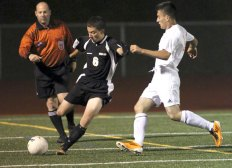 Adam Baz and the Woodland boys soccer team won its first ever NVL title last fall. –RA ARCHIVE