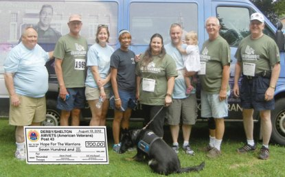 Steve Frank, of Naugatuck, second from the right, led the Derby/Shelton AMVETS Post 43 team in the 3rd Annual Sunset Run For The Warriors in Huntington on Aug. 19 to raise money for Hope For The Warriors. The team raised $700. Team members pictured with Frank, from left, Tim Huff, Mary Beth Perelli, Air Force Medic Seana Barr Lauren Cust, who was wounded in Iraq, National Guard veteran Mike Cust, Mary May and Lauren Cust's service dog Dorothy, Ed Michaud, and Al Meadows. Huff, Frank, Michaud, and Meadows were all wounded in combat during the Vietnam War. -CONTRIBUTED