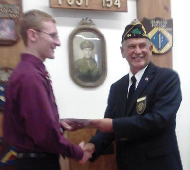 Woodland Regional High School graduate Eric Dietz, left, receives a scholarship from American Legion Post 154 Post Commander Lucien H. Lefevre. Dietz, who graduated in 2012, attends Keene State College in Keene, N.H. -CONTRIBUTED