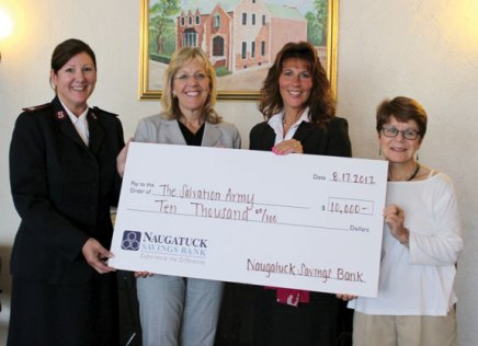 Naugatuck Savings Bank Branch Manager Teresa Carrier, second from right, and the banks' Vice President Commercial Lending Sharon Mansfield, second from left, present a $10,000 check to Corps Officer Major Annette Lock of The Salvation Army of Greater Waterbury, left, and Jennifer Meligonis DeJohn, grants manager for The Salvation Army, to support the Family Emergency Shelter. The money will support the Salvation Army's Family Emergency Shelter in Waterbury. -CONTRIBUTED