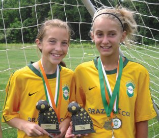 Eliza Smith of Beacon Falls, left, and Michealla Mastropietro of Prospect show off their championship trophies and medals earned playing this summer with the Brazil CT team out of Woodbridge. -CONTRIBUTED