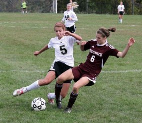Naugatuck's Emma Colucci (6) slides in to knock the ball away from Woodland's Hope Gavigan (5) Monday morning in Beacon Falls. The Hawks defeated the Greyounds, 3-0. –ELIO GUGLIOTTI