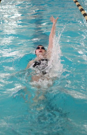 Woodland's Emily Trumbley does the backstroke during the 200 medley relay versus Kennedy Oct. 22 in Beacon Falls. The medley relay team of Trumbley, Sarah Parker, Chrissy Leeper, and Sydney Corneau won the event in 2:10.22. –ELIO GUGLIOTTI