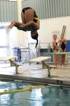 Woodland's Kim Thrasher dives during a swim meet versus Kennedy Oct. 22 in Beacon Falls.