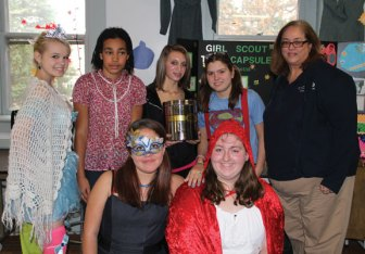 Senior Girl Scouts from Troop 64538 presented a time capsule Oct. 28 at the Grange Hall in Prospect to Waterbury Girl Scout council representative Carmen Richtarich. The senior scouts from Beacon Falls and Prospect have been working on their Sisterhood Journey and chose to do a time capsule as their project in celebration of the 100th year anniversary of Girl Scouts. The time capsule will be held by the council and opened in 25 years. Pictured, from left kneeling, scouts Tori Skehan and Kate Rosa. Standing, from left, scouts Mysti Dahlman, Samantha Nuss, Elaine Ferretti, Kayla Sciarretti and Richtarich. -CONTRIBUTED