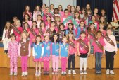 As part of Breast Cancer Awareness Month, the Brownies and Juniors of Girl Scout Troop 64558 brought a little pink to Laurel Ledge Elementary School Oct. 19. At their October meeting, they made pink ribbons and distributed them to the entire staff at Laurel Ledge to wear. The scouts in Region 16 organized a 'Girl Scouts Go Pink' and encouraged staff and classmates to join them in wearing pink for the day. -CONTRIBUTED