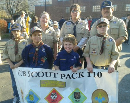 Cub Scouts from Pack 110 marched in the Veterans Day Parade in Naugatuck Nov. 11. Scouts, from left, Michael Els, Christopher Minutolo, Mathew Bryant, and Ryan McCarthy. Scout leaders, from left, Jenn Bryant, Dawn Minutolo, and Ed McCarthy.-CONTRIBUTED