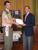 Boy Scout Christopher Giaquinto of Troop 104 in Beacon Falls, left, is presented a proclamation from U.S. Senator Richard Blumenthal (D-Conn.) during an Eagle Scout Court of Honor Dec. 2 at which Giaquinto earned the rank of Eagle Scout. For his Eagle Scout project, Giaquinto planned, organized, and facilitated a troop drive to send care packages to military personnel. He raised $1,933 and sent 112 care packages, surpassing his goal of 40 care boxes. Also in attendance at the Court of Honor was State. Rep. Len Greene Jr. (R-105). -CONTRIBUTED