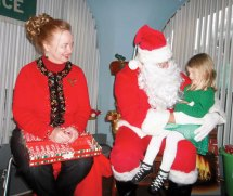 Santa visited the Horgan Academy of Irish Dance in Naugatuck on Dec. 9. Dancers performed traditional Irish dances for Santa and enjoyed dinner with their families and friends. Pictured, from left, Irish dance teacher Maureen Horgan, Santa, dancer Leah. -CONTRIBUTED