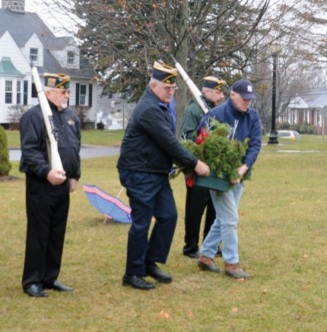 Don Bragg, left, Bob Moraniec, Doug Merriman, and Walter Shea, all from American Legion Post 194 in Prospect, lay a wreath at the foot of the town's war memorial Dec. 7 to commemorate the 71st anniversary of the attack on Pearl Harbor. -CONTRIBUTED