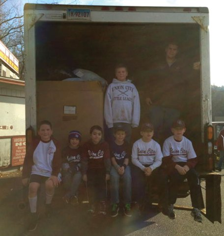 Union City Little League recently teamed up with American Service U.S.A. to hold a clothing drive and fundraiser. A total of 220 bags were collected. UCLL Director Sergio Carreira thanked everyone for their donation and support. Pictured, sitting from left, James McSweeney, Damon and Anthony Abate, Dylan Trochsler, Tim and Nate Gairing. Standing, Dylan Carreira, left, and Bob, owner of of American Services. –CONTRIBUTED
