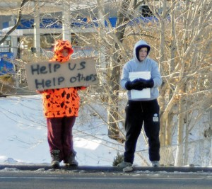 Prospect Congregational Church Senior Youth Fellowship members Mike Normand, left, and John Searles stand at the intersection of Routes 68 and 69 on Sunday morning collecting money for the homeless. –LUKE MARSHALL