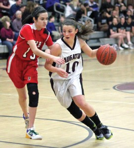 Naugatuck's Angelina Piccirillo (10) drives past Derby's Amanda Dean (13) last Friday night in Naugatuck. Piccirillo had 23 points as the Greyhounds won, 68-37. The Greyhounds can clinch a state tournament bid with their next win. –ELIO GUGLIOTTI