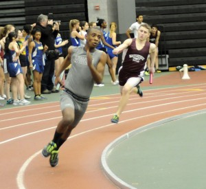 Woodland's Hunter Watford runs in the 4-by-200 Tuesday at the Naugatuck Valley League indoor track championships in New Haven. The Woodland boys can in second at the meet. –LUKE MARSHALL
