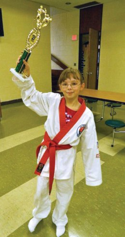Kathleen Robinson shows off her first place award in sparring won Jan. 20 at a Cheezic Tang Soo Do Karate Tournament at Holy Cross High School in Waterbury. Karate students from USA Martial Arts in Naugatuck excelled at the tournament. In the sparring division Aidan Lyons, Robinson, Michele Bernardini, Noah Santoro, Maurice Myers and Javon Lopez won first place. Mitchell Sullivan and Jonathan Velasquez won second place. Emil Lizak and Lauren Mulinski won third. In the weapons division, Nathaniel Smith, Mitchell Sullivan, Javon Lopez and Neil Mascola won first place. Liz Recce came in second as Jonathan Velasquez and Noah Santoro won third place.