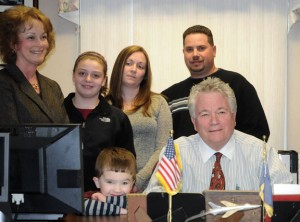 Prospect Mayor Robert Chatfield, seated, announced he is running for reelection Tuesday night surrounded by family and friends in the Mayor's Office in Town Hall. –LUKE MARSHALL