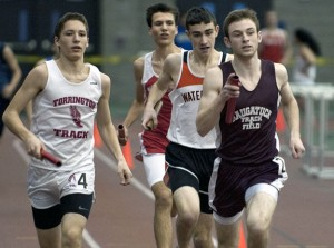 Naugatuck's Collin Reilly, right, seen anchoring the 4-by-800 relay during the NVL indoor track and field championships in January, won a gold medal in the 600 meters at the Class L state championship meet Feb. 15. –RA ARCHIVE