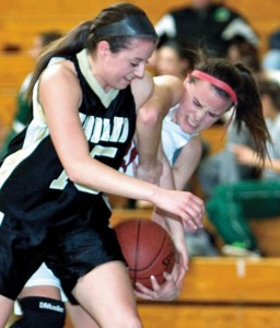 Brianna Pacileo (15) of Woodland battles with Olivia Morrison (30) of Torrington for a rebound during the Naugatuck Valley League tournament at Holy Cross High School in Waterbury Monday. –RA ARCHIVE