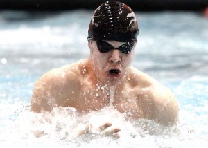 Naugatuck's Adam Branco swims the breast stroke during the 200 yard medley relay during the Class L swimming championships in Middletown Tuesday afternoon.-RA ARCHIVE