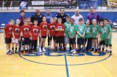 The Bulls and the Celtics from the Beacon Falls Basketball League's 8 to 9 year old division played at halftime of the Southern Connecticut State University mens basketball game Feb. 2 to promote Project Purple, a nonprofit organization that raises awareness and funds towards a cure for pancreatic cancer founded by Dino Verrelli of Beacon Falls. Over 150 people from the basketball league came down to support Project Purple Feb. 2. Pictured members of the Bulls and Celtics with their coaches, from left, Tara Rindos, Bill Brooks, Tom Deegan, Chris Anderson, Jim Dawes and Verrelli. -CONTRIBUTED