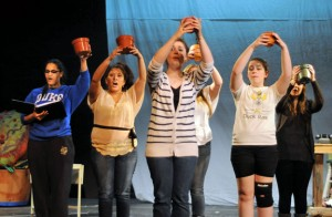 The Woodland Theatre chorus practices a song during rehearsal last week for the production of the 'Little Shop of Horrors.' –LUKE MARSHALL
