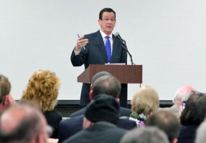 Gov. Dannel Malloy addresses the crowd during a community forum Wednesday night at Naugatuck High School. –ELIO GUGLIOTTI
