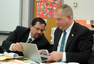 Naugatuck Board of Education members James Jordan, left, and Scott Slauson look over a Google Chromebook during the board's meeting March 14. Chromebooks are one of the technology upgrades Information Technology Director Alan Merly is proposing for next school year. –LUKE MARSHALL