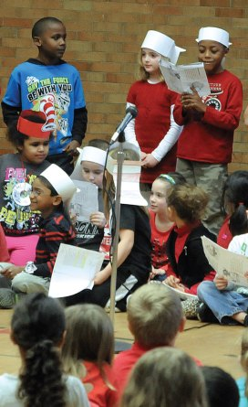 Local schools celebrated Read Across America March 1 in honor of Dr. Seuss' birthday, which was March 2, with guest readers, dressing up and reading their favorite books. First-graders at Hop Brook Elementary School in Naugatuck read the poem 'Sick' by Shel Silverstein during an assembly at the school. –LUKE MARSHALL