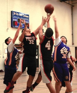 Joe Kwaak (32) and Tyler Waters (4) of Post 17 battle on the boards with the Elks' Christian Bonillia (30) and Zack Alves (40) Monday night during Naugatuck YMCA Little Pal championship series at City Hill Middle School. –KEN MORSE