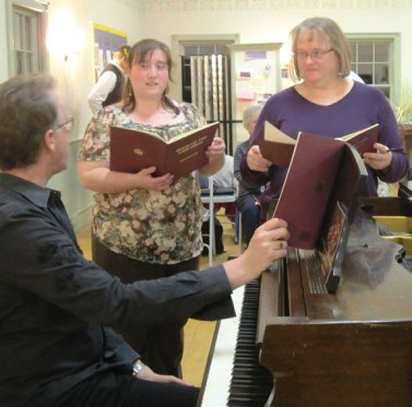 """Naugatuck resident Janine Lempke, right, rehearses recently with the Connecticut Choral Society. Lempke will be singing with the Connecticut Choral Society in """"INSPIRE,"""" a May 18 concert at 8 p.m. at the First Congregational Church in Danbury and May 19, at 3 p.m. at the Congregational Church in Naugatuck. Lempke, a music teacher in Woodbridge and church choir director in New Haven, will be featured in a trio singing an excerpt from John Rutter's Mass of the Children. Tickets are $25 for adults and $15 for youth. For tickets, visit www.ctchoralsociety.org or call (203) 206-7186. Tickets also will be available at the door. –LORI MCHUGH"""
