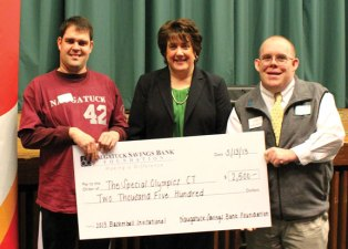 The Naugatuck Savings Bank Foundation recently awarded a $2,500 grant to Special Olympics Connecticut to support its 2013 Basketball Invitational, a one day tournament held in Waterbury that features teams consisting solely of individuals with intellectual disabilities. Pictured, from left, Special Olympics athlete from Naugatuck Jake Segla, Naugatuck Savings Bank Vice President of Human Resources Kathleen McPadden and Regional Global Messenger Assistant for Special Olympics Connecticut Raymond Hadden III. –CONTRIBUTED