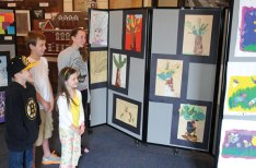 Naugatuck students James Jordan, back left, Ben Johnson, Rylee Jordan, front left, and Kelly Murphy look over artwork displayed at the Naugatuck Historical Society Museum. The art was created by Naugatuck residents, including students in kindergarten through 12th grade, and is part of the historical society's 5th Annual Art Show this month. For more information on the show, call the museum at (203) 729-9039. Naugatuck Historical Society President Wendy Murphy said that this is the fifth year the art show has been held at the museum and the third year that it has featured student's artwork. –LUKE MARSHALL