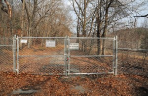 A locked gate with 'No Trespassing' signs blocks public access to the Naugatuck State Forest at the end of Cold Spring Road in Beacon Falls. The state Department of Transportation, which feels that the road is unsafe and plans to keep it closed indefinitely, has agreed to open the road for the annual kayak race to allow organizers access to the river for any distressed racers. –FILE PHOTO
