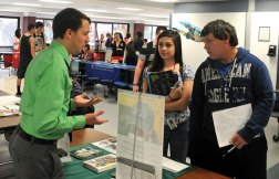 Ken Scupp, left, from Mount Ida College in Massachusetts discusses college with Naugatuck High School juniors Maria Carranza and Nate Lindsly April 9 during college fair for juniors and seniors at the school. –LUKE MARSHALL