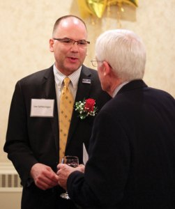 Mary H. Connolly Community Caring Award recipient Lee Schlesinger, left, talks with Joseph Carlson during the United Way of Naugatuck and Beacon Falls annual meeting April 11 at the Crystal Room in Naugatuck. –ELIO GUGLIOTTI