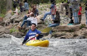 Michael Duda of Beacon Falls kayaks down the Naugatuck River in Beacon Falls during last year's Naugatuck Valley Canoe and Kayak River Race. The race will once again be held in conjunction with the Beacon Falls Duck Race on May 4. –FILE PHOTO