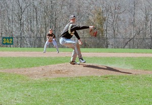 Woodland's Tanner Kingsley comes home with a pitch Monday versus Naugatuck in Beacon Falls. Kingsley scattered six hits through five innings and struck out six to lead the Hawks over the Greyhounds. –KEN MORSE
