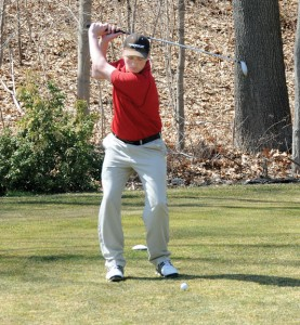 Naugatuck High School junior Nick Trieanaj tees off April 9 during a scrimmage against Holy Cross at Hop Brook Golf Course in Naugatuck. –LUKE MARSHALL