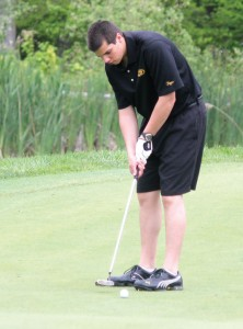 Woodland junior Andy O'Dell sinks a birdie putt last season at Oxford Greens in Oxford. The Hawks headed into the season looking to build on a seventh place finish in last year's Naugatuck Valley League championship. –FILE PHOTO
